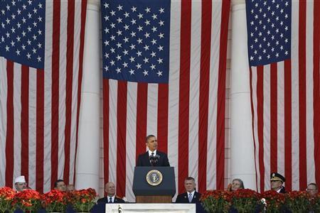 U.S. President Barack Obama stands for Veterans Day remarks at Arlington National Cemetery in Arlington, Virginia, November 11, 2012. REUTERS/Jonathan Ernst