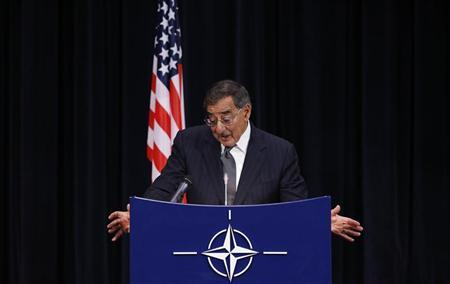 U.S. Secretary of Defense Leon Panetta reacts as he answers questions during a NATO defence ministers meeting at the Alliance headquarters in Brussels October 10, 2012. REUTERS/Francois Lenoir