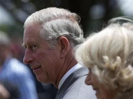 Britain's Prince Charles walks with his wife Camilla, Duchess of Cornwall, to the naming ceremony of Queen Elizabeth Terrace in Canberra November 10, 2012. REUTERS/Andrew Taylor