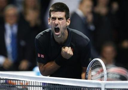Serbia's Novak Djokovic celebrates beating Switzerland's Roger Federer in their final tennis match during the ATP World Tour Finals at the O2 Arena in London November 12, 2012. REUTERS/Suzanne Plunkett