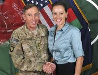 Commander of the International Security Assistance Force/U.S. Forces in Afghanistan General David Petraeus shakes hands with author Paula Broadwell in this ISAF handout photo originally posted July 13, 2011. REUTERS/ISAF/Handout