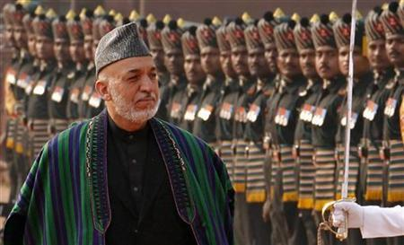 Afghanistan's President Hamid Karzai inspects the guard of honour during his ceremonial reception at the forecourt of Rashtrapati Bhavan in New Delhi November 12, 2012. REUTERS/B Mathur