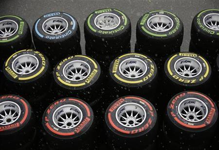 Pirelli tyres are seen in the paddock as it rains ahead of the first practice session of the Singapore F1 Grand Prix at the Marina Bay Street Circuit September 21, 2012. REUTERS/Tim Chong (SINGAPORE - Tags: SPORT MOTORSPORT F1)