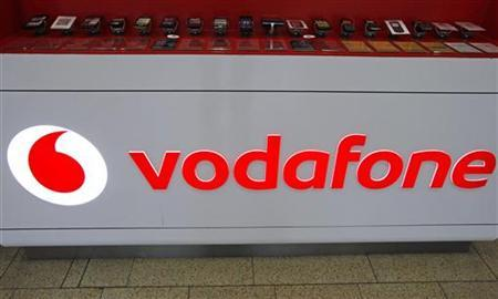 The Vodafone logo is seen at the counter of the shop in Prague February 7, 2012. REUTERS/David W Cerny