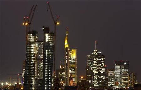 The construction site of the new headquarters of the European Central Bank (ECB) (L) is seen in front of the city's skyline with its banking towers, in Frankfurt, late October 11, 2012. REUTERS/Kai Pfaffenbach (GERMANY - Tags: BUSINESS CITYSPACE)