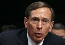 "CIA Director David Petraeus speaks to members of a Senate (Select) Intelligence hearing on ""World Wide Threats"" on Capitol Hill in Washington in this January 31, 2012 file photo. President Barack Obama on November 9, 2012 accepted the resignation of CIA Director David Petraeus, praised him as as one of the most outstanding generals of his generation and expressed confidence that the intelligence agency would continue to thrive. REUTERS/Kevin Lamarque/Files (UNITED STATES - Tags: POLITICS HEADSHOT)"