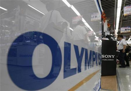 Logos of Olympus and Sony are pictured at an electronic store in Tokyo September 28, 2012. REUTERS/Kim Kyung-Hoon/Files