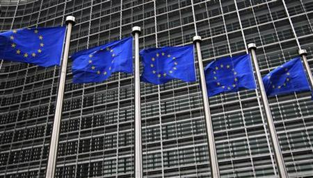 European Union flags fly in front of the European Commission headquarters in Brussels October 12, 2012. REUTERS/Yves Herman/Files