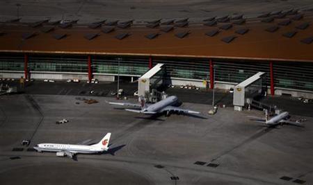 Air China planes can be seen on the tarmac at the Beijing Capital International Airport July 3, 2012. REUTERS/David Gray/Files