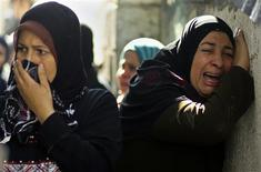 Palestinian relatives of Hamas militant Mohammed Qanoua, who died of wounds suffered from Israeli tank fire, mourn during his funeral in Gaza City November 13, 2012. Israel struck three targets in the Gaza Strip in the early hours of Tuesday and warned an on-going crisis with Palestinian militants had not been resolved, despite a marked decrease in rocket-fire from the territory. Tensions rose sharply on Saturday when four Israeli soldiers patrolling the Israel-Gaza border were wounded. Israel responded with tank fire and air strikes that killed seven Palestinians, including four civilians, and left at least 40 wounded. REUTERS/Mohammed Salem