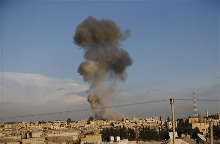 Smoke rises over the Syrian town of Ras al-Ain after an air strike, seen from the Turkish border town of Ceylanpinar, Sanliurfa province November 12, 2012. REUTERS/Murad Sezer