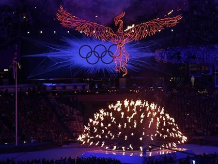 A flaming phoenix flies above the Olympic flame during the closing ceremony of the London 2012 Olympic Games at the Olympic Stadium August 12, 2012. REUTERS/Luke Macgregor
