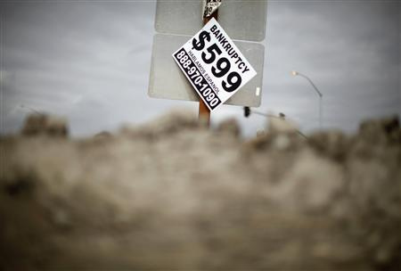 A sign advertising bankruptcy filing is seen hanging off a road sign in San Bernardino, California September 11, 2012. The city of about 210,000, some 65 miles (104 km) east of Los Angeles, filed for bankruptcy on August 1, joining the Bay Area city of Stockton as a test case for whether financially troubled municipalities can shed bond payments and possibly pension obligations via bankruptcy court. Picture taken September 11, 2012. To match Special Report BERNARDINO/BANKRUPT REUTERS/Lucy Nicholson