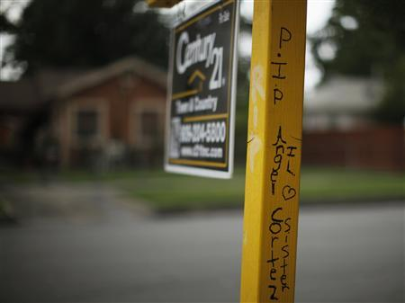 Graffiti in memory of 21-year-old Angel Cortez is seen on the real estate sign in front of the home in which he was murdered in San Bernardino, California September 11, 2012. The city of about 210,000, some 65 miles (104 km) east of Los Angeles, filed for bankruptcy on August 1, joining the Bay Area city of Stockton as a test case for whether financially troubled municipalities can shed bond payments and possibly pension obligations via bankruptcy court. Picture taken September 11, 2012. To match Special Report BERNARDINO/BANKRUPT REUTERS/Lucy Nicholson