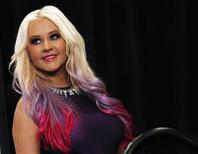 Christina Aguilera poses after a news conference to announce the 40th Anniversary American Music Awards nominations in Los Angeles, California October 9, 2012. REUTERS/Mario Anzuoni