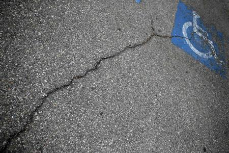 Cracks in the parking lot are seen in front of the Carousel shopping mall in San Bernardino, California September 11, 2012. REUTERS/Lucy Nicholson (UNITED STATES - Tags: POLITICS BUSINESS)