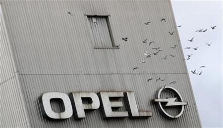 Birds fly beyond a logo of German car manufacturer Opel at the headquarters in Ruesselsheim November 12, 2012. REUTERS/Lisi Niesner