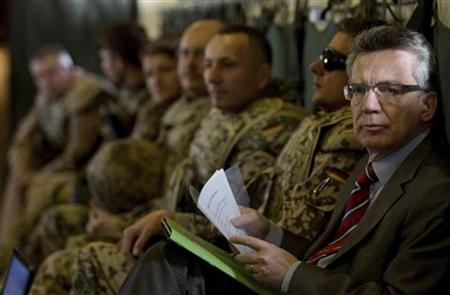 German Defence Minister Thomas de Maiziere sits in a Transall C-160 aircraft enroute from Masar-i-Sharif to Kabul, November 12, 2012. REUTERS/Oliver Lang/Pool (AFGHANISTAN - Tags: MILITARY POLITICS)
