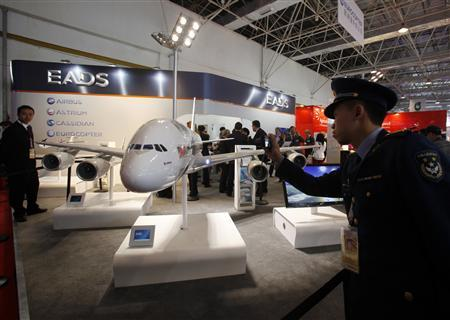 A People's Liberation Army (PLA) officer takes a photo of a model of the Airbus A380 passenger plane displayed on the first day of the China International Aviation & Aerospace Exhibition in the southern Chinese city of Zhuhai November 13, 2012. REUTERS/Bobby Yip