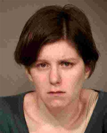 Holly Solomon, 28, is shown in this booking photo supplied by the Gilbert Arizona Police Department supplied to Reuters November 12, 2012. REUTERS/Gilbert Arizona Police Dept/Handout