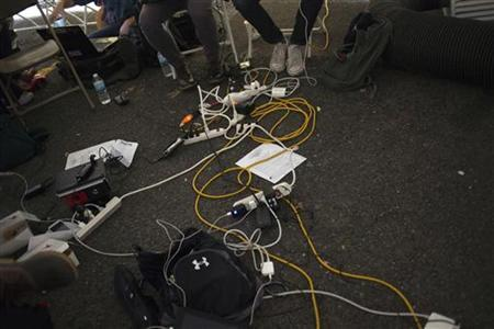 Electrical cables are seen in a tent providing free power and internet for victims of Hurricane Sandy in Hoboken, New Jersey on November 2, 2012. REUTERS/Adrees Latif