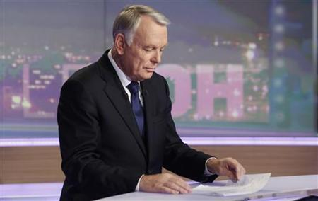 France's Prime Minister Jean-Marc Ayrault poses for photographers prior to an interview during the evening broadcast news of French TV channel TF1 in Boulogne-Billancourt, near Paris, November 6, 2012. REUTERS/Thibault Camus/Pool