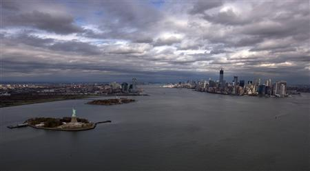 The Statue of Liberty, Liberty Island and Ellis Islands are seen to the left next to New York's Lower Manhattan skyline in this aerial image taken in New York October 31, 2012. REUTERS/Adrees Latif