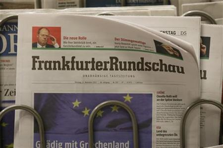 Copies of German newspaper ''Frankfurter Rundschau'' are displayed for sale at a store in Berlin November 13, 2012. The daily newspaper on Tuesday declared bankruptcy, German media reported. REUTERS/Tobias Schwarz (GERMANY - Tags: SOCIETY BUSINESS)