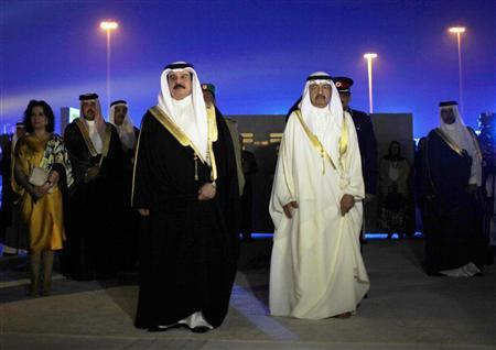 Bahrain's King Hamad bin Isa al-Khalifa (L) and Prime Minister Prince Khalifa bin Salman al-Khalifa arrive at the inauguration ceremony of the Bahrain National Theatre in Manama November 12, 2012. The 1001-seat theatre, one of the biggest in the Arab world, is expected to host major international and regional events promoting arts and culture in the area. REUTERS/Ahmed Jadallah