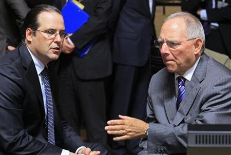 Sweden's Finance Minister Anders Borg (L) talks with his German counterpart Wolfgang Schaeuble (R) at a European Union finance ministers meeting in Luxembourg October 9, 2012. REUTERS/Yves Herman