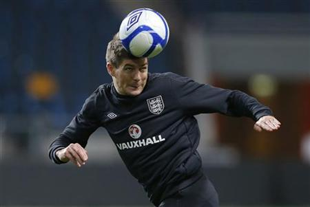 England's Steven Gerrard heads a ball during a training session at the Friends Arena in Stockholm November 13, 2012. REUTERS/Phil Noble