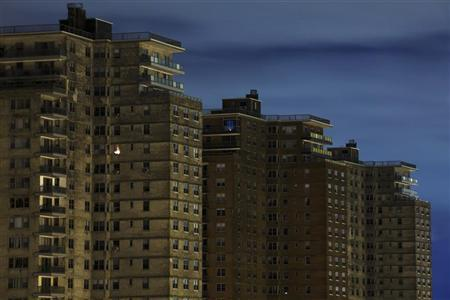 A single room is illuminated in a block of high-rise apartment buildings that remain devoid of power, heat, and water in the Brighton Beach neighborhood of New York, November 2, 2012. REUTERS/Lucas Jackson