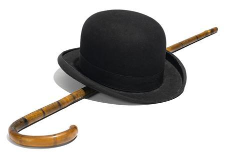 A bowler hat and cane that belonged to silent film star Charlie Chaplin is shown in this publicity photo released to Reuters November 13, 2012. Chaplin's iconic trademarks, the staple of Hollywood silent-era comedy, will go under the hammer in Los Angeles this weekend, auction house Bonhams said on Tuesday. REUTERS/Bonham's/Handout