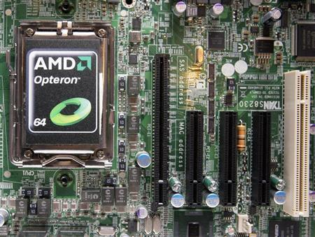 A new AMD Opteron 6000 series processor is seen on a motherboard during a product launch in Taipei April 14, 2010. REUTERS/Pichi Chuang