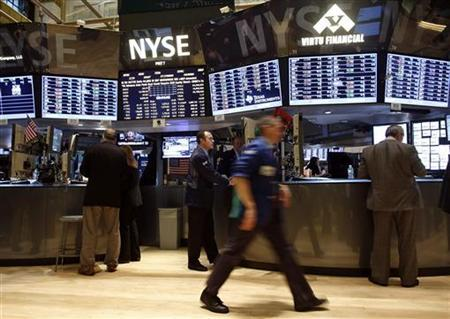 Traders of Virtu Financial work at a newly renovated section of trading stations on the floor of the New York Stock Exchange, November 13, 2012. REUTERS/Chip East