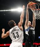 Minnesota Timberwolves forward Chase Budinger dunks the ball in front of Brooklyn Nets forward Kris Humphries in the first quarter of their NBA basketball game in New York November 5, 2012. REUTERS/Adam Hunger