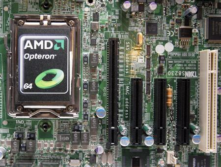 A new Advanced Micro Devices (ADM) Opteron 6000 series processor is seen on a motherboard during a product launch in Taipei in this April 14, 2010 file photo. ADM has hired JPMorgan Chase & Co to explore options, which could include a potential sale, as the chipmaker struggles to find a role in an industry increasingly focused on mobile and away from traditional PCs, according to three sources familiar with the situation. REUTERS/Pichi Chuang/Files