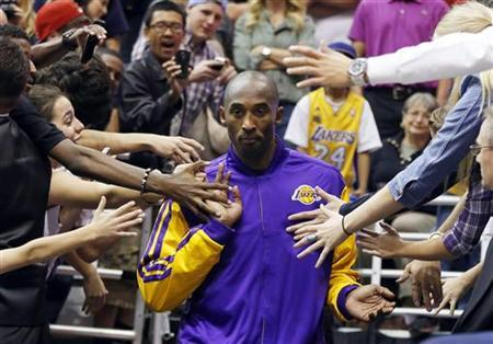 Los Angeles Lakers guard Kobe Bryant walks past fans before the second half of their NBA basketball game against the Utah Jazz in Salt Lake City, Utah, November 7, 2012. REUTERS/Jim Urquhart