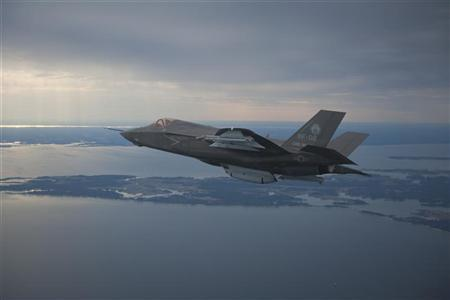 The U.S. Marine Corps version of Lockheed Martin's F35 Joint Strike Fighter, F-35B test aircraft BF-2 flies with external weapons for the first time over the Atlantic test range at Patuxent River Naval Air Systems Command in Maryland on February 22, 2012. REUTERS/Lockheed Martin/Handout