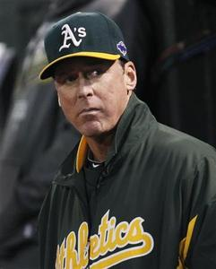 Oakland Athletics manager Bob Melvin watches from the dugout as his team plays the Detroit Tigers in Game 4 of their MLB ALDS playoff baseball series in Oakland, California October 10, 2012. REUTERS/Robert Galbraith