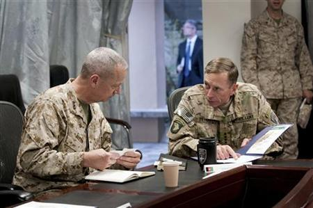 General John R. Allen (L), incoming commander, International Security Assistance Force (ISAF)/U.S. Forces- Afghanistan (USFOR-A) and General David H. Petraeus, commander, ISAF/USFOR-A, attend a meeting in Kabul, Afghanistan in this July 9, 2011 file photograph. The top U.S. commander in Afghanistan, General John Allen, is under investigation for alleged inappropriate communication with a woman at the center of the scandal involving former CIA Director David Petraeus, a senior U.S. defense official said on November 13, 2012. REUTERS/Joshua Treadwell/U.S. Navy/Handout