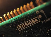 A logo of Toshiba Corp is seen on a printed circuit board in this photo illustration taken in Tokyo July 31, 2012. REUTERS/Yuriko Nakao