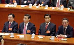 (From L to R) Standing Committee of the Political Bureau member He Guoqiang, China's Vice President Xi Jinping, top political advisor Jia Qinglin and chairman of the Standing Committee of National People's Congress Wu Bangguo attend the closing session of 18th National Congress of the Communist Party of China at the Great Hall of the People in Beijing, November 14, 2012. REUTERS/Jason Lee