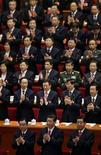 """(Front row, from L to R) Standing Committee of the Political Bureau member He Guoqiang, China's Vice President Xi Jinping, top political advisor Jia Qinglin, and fellow delegates clap their hands after listening to the """"L'Internationale"""" at the closing session of 18th National Congress of the Communist Party of China at the Great Hall of the People in Beijing, November 14, 2012. REUTERS/Jason Lee (CHINA - Tags: POLITICS)"""