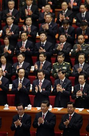 (Front row, from L to R) Standing Committee of the Political Bureau member He Guoqiang, China's Vice President Xi Jinping, top political advisor Jia Qinglin, and fellow delegates clap their hands after listening to the ''L'Internationale'' at the closing session of 18th National Congress of the Communist Party of China at the Great Hall of the People in Beijing, November 14, 2012. REUTERS/Jason Lee (CHINA - Tags: POLITICS)