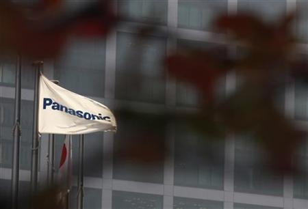 A flag of Panasonic Corp is pictured past autumn leaves outside the company's showroom in Tokyo November 1, 2012. REUTERS/Yuriko Nakao
