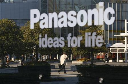 A man is reflected in a sign at Panasonic Corp's showroom in Tokyo November 14, 2012. REUTERS/Toru Hanai