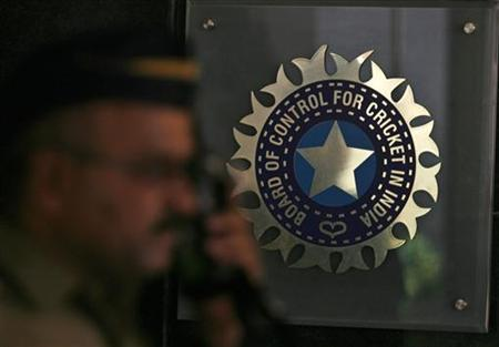 A policeman walks past a logo of the Board of Control for Cricket in India (BCCI) during a governing council meeting of the Indian Premier League (IPL) at BCCI headquarters in Mumbai April 26, 2010. REUTERS/Arko Datta