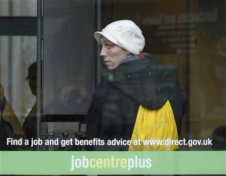 A man looks from the window of a Job Centre in Leicester, central England, November 16, 2011. REUTERS/Darren Staples
