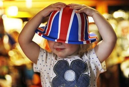 23 month old Scarlett Rose Green tests a Union flag bowler hat for size at The Jubilee pub ahead of the Queen's diamond jubilee celebrations in Sunbury-on-Thames in south west London May 30, 2012. REUTERS/Luke MacGregor